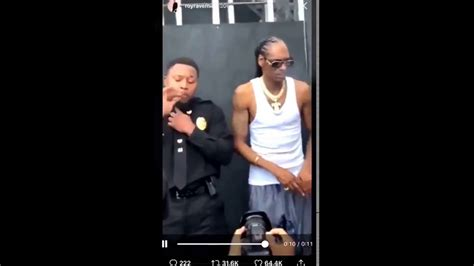 Snoop Dogg passes a blunt to a cop - YouTube