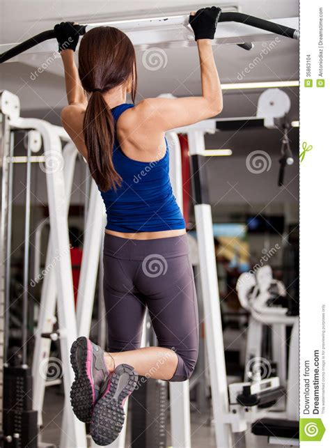 Young Woman Doing Pull Ups Stock Images - Image: 35863104